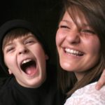 boy and sister laughing